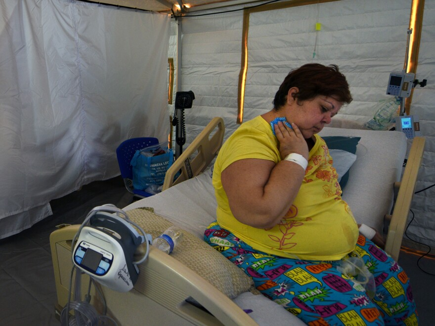 """U.S. Disaster Medical Assistance Teams erected two cooled emergency rooms for critically ill patients at the hospital in Arecibo, Puerto Rico, where temperatures on the 6th floor soared to 112 degrees one day. Sarilin Lopez, grateful to be in the field hospital, says, """"It was so hot I could hardly breathe."""""""
