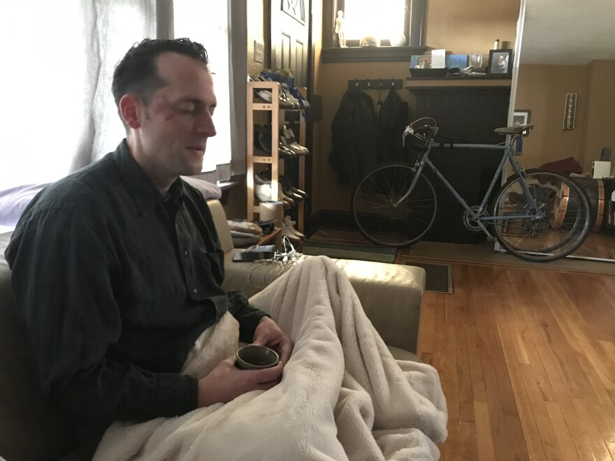 Dan Conner sits up to sip some tea during the peak of a recent psychedelic experience.
