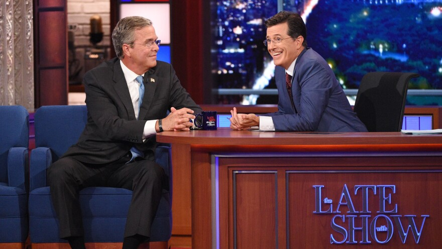 Stephen Colbert (right) talks with Republican presidential candidate Jeb Bush during Colbert's debut as <em>Late Show</em> host in New York.