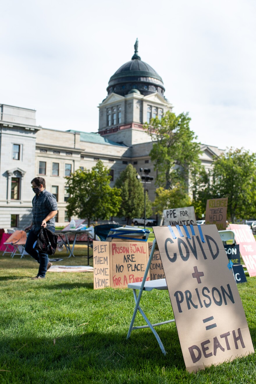 Signs line the Montana capitol lawn that say