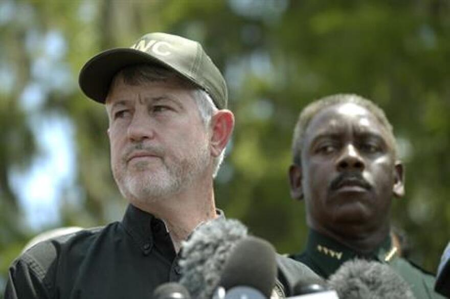 Nick Wiley, executive director of the Florida Fish & Wildlife Conservation Commission, left, and Orange County Sheriff Jerry Demings answer questions during a news conference Wednesday, June 15, 2016, in Lake Buena Vista, Fla.