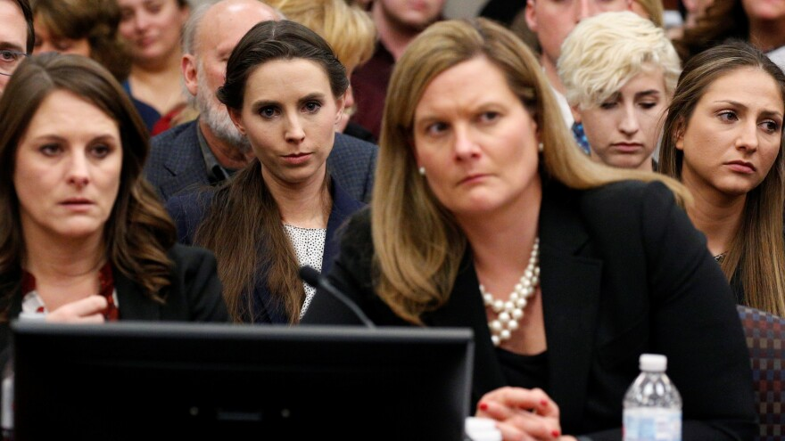 The entire USA Gymnastics board will resign, the group says. Rachael Denhollander (center) listens as Larry Nassar, a former team USA Gymnastics doctor, was sentenced to up to 175 years in prison for sexual abuse over decades of his involvement with the program.