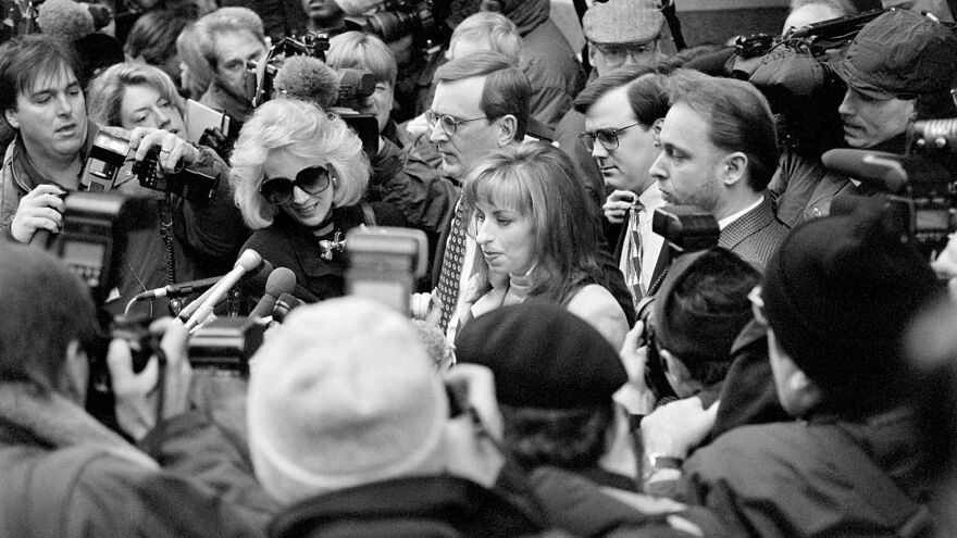 Former Arkansas employee Paula Jones (center, with long hair) sued Bill Clinton for civil money damages in 1994 alleging that Clinton had propositioned her in a Little Rock hotel room years earlier.