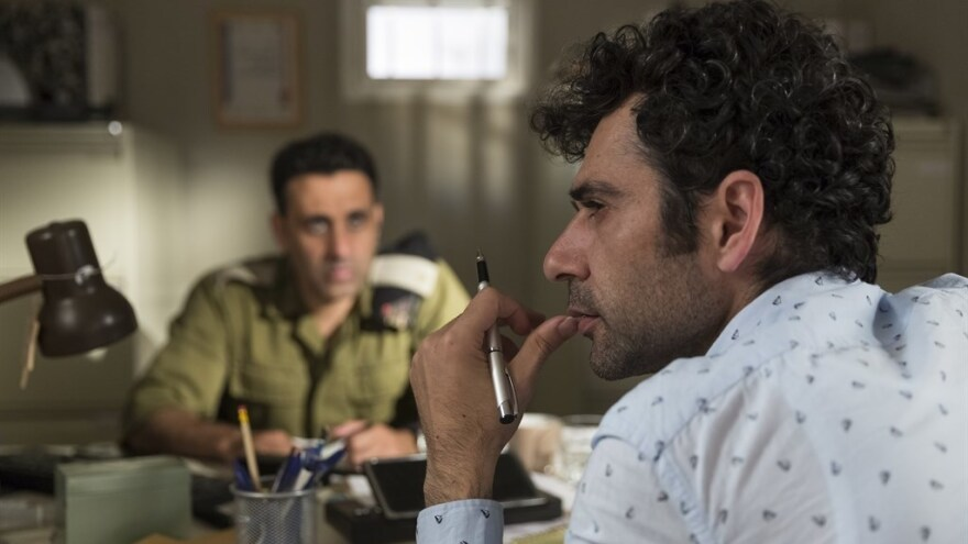 Palestinian screenwriter Salam (Kais Nashef, R) takes script advice from Israeli officer Assi (Yaniv Biton, L) in this satire by Sameh Zoabi.