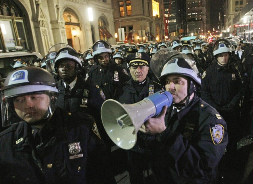 In this Nov. 15 file photo, police officers disperse Occupy Wall Street protesters near the encampment at Zuccotti Park in New York.