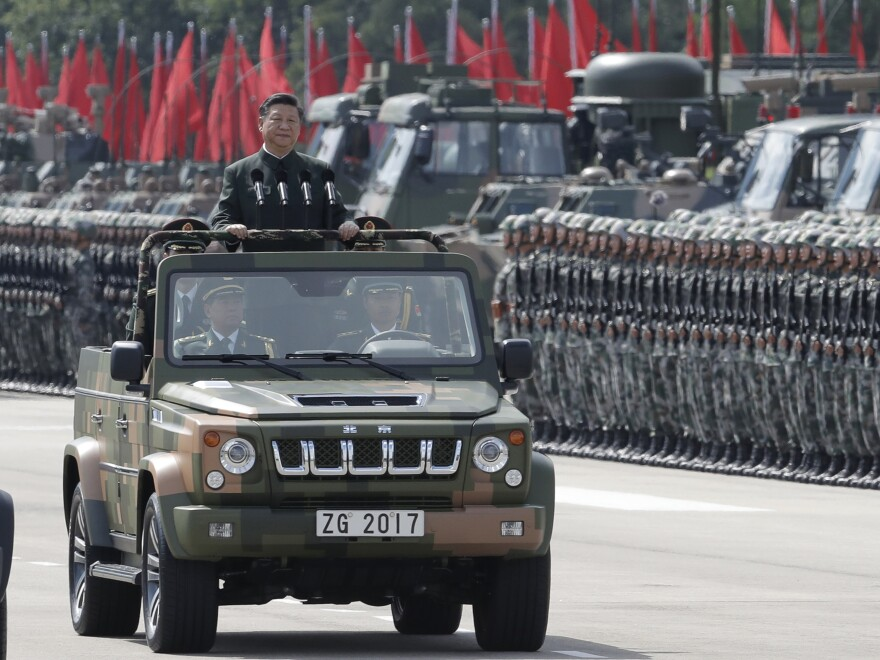 Chinese President Xi Jinping inspects Chinese troops of the People's Liberation Army in Hong Kong on Friday. Xi landed in Hong Kong Thursday to mark the 20th anniversary of Beijing taking control of the former British colony.