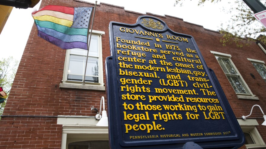A historical marker stands outside Giovanni's Room in Philadelphia. Owner Ed Hermance says he plans to close the doors for good later this month.