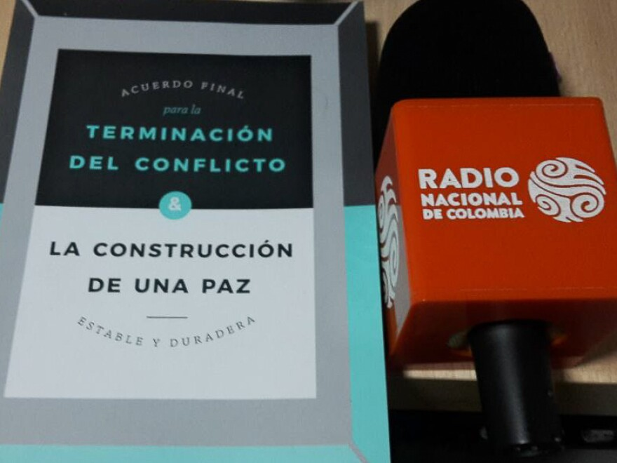A copy of the 2016 Colombian peace accords is next to a microphone at the new public radio station in Ituango. The station focuses on educating its audience about the peace process.