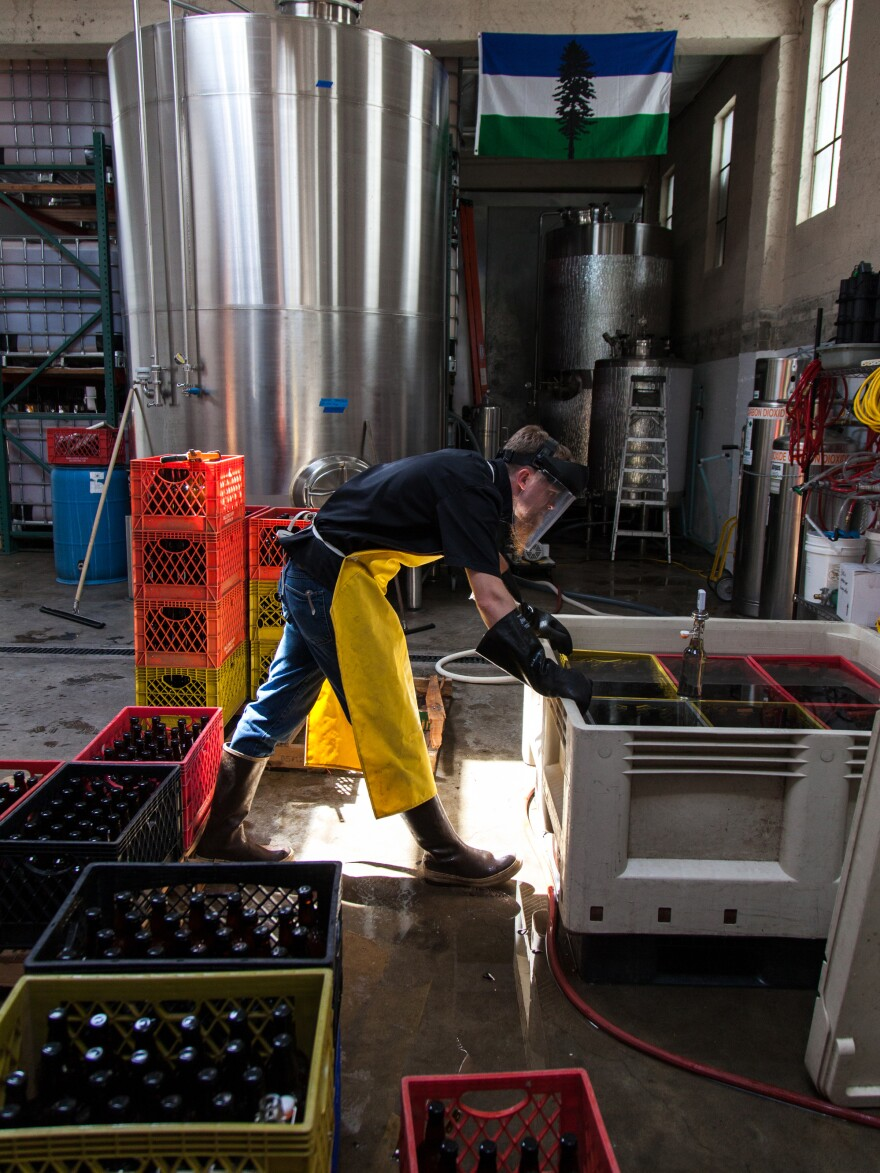 Nat West checks the pasteurization temperatures at his cidery in Portland, Ore.