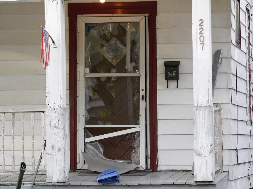 It took neighbors' help for Amanda Berry to escape through the bolted storm door of the Cleveland home where authorities say she and two other women were held captive for nearly a decade. After she emerged, the women and Berry's daughter were rescued.