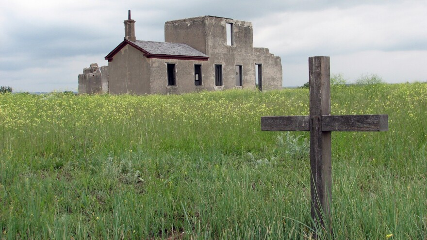 A wooden cross marks an unidentified U.S. Army grave at Fort Laramie, Wyo., as pictured in 2009. The Fort Laramie National Historic Site will host a gathering of Lakota people this weekend to commemorate an 1868 treaty with the U.S. government.