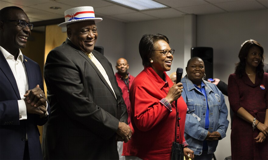 Charlene Jones, a longtime political and education strategist who managed the Prop 1 campaign, speaks to a cheerful crowd at St. Louis Public Schools' downtown headquarters after watching election results come in.