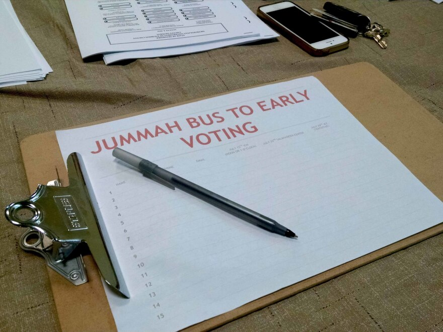 A sign-up sheet for the bus to early voting after Friday prayers