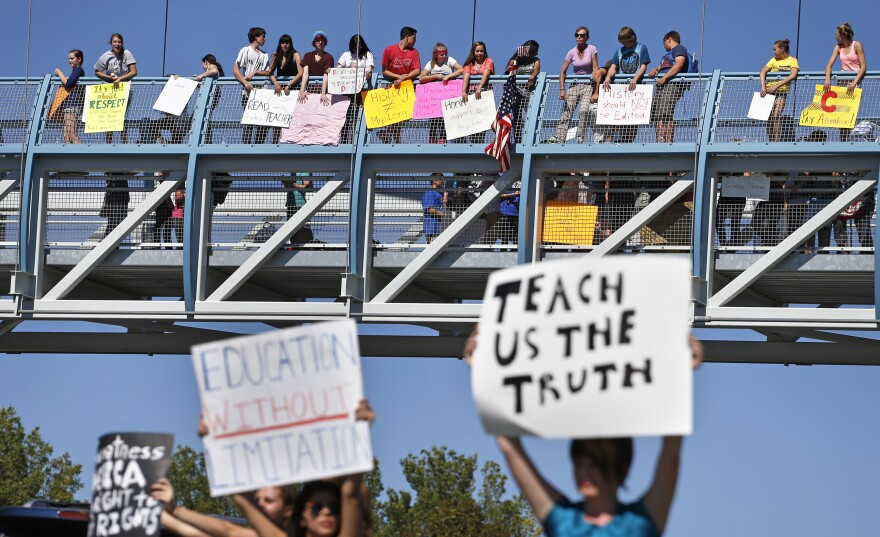 Students line a busy intersection and overpass  in the Denver suburb of Littleton, Colo., on Sept. 25, protesting a Jefferson County School Board proposal to emphasize patriotism and downplay civil unrest in the teaching of U.S. history.