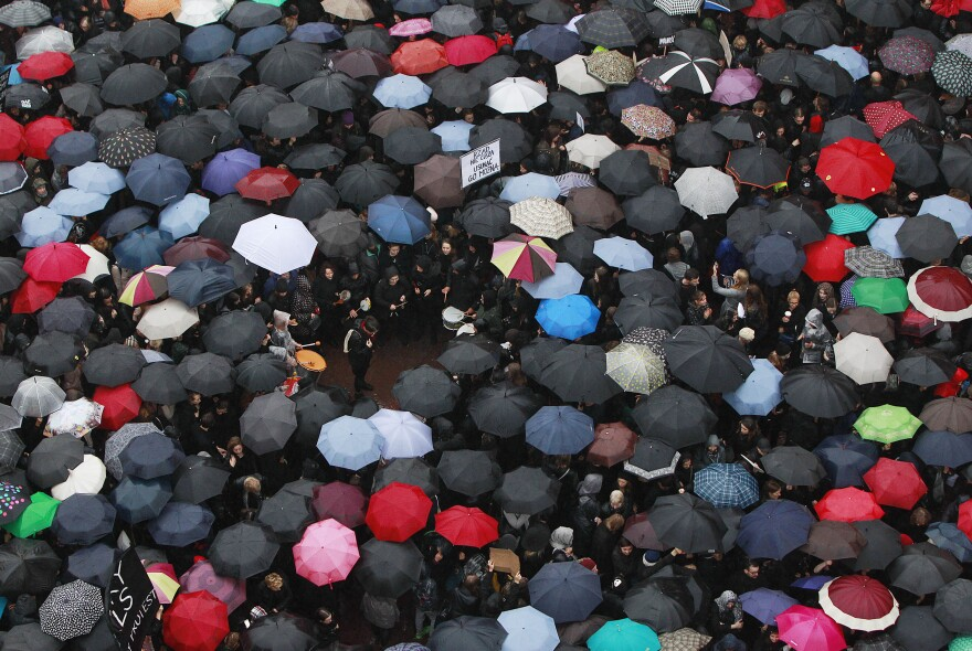 """A sea of umbrellas fill downtown Castle Square in Warsaw, Poland, on Monday, as thousands of women and men participated in a nationwide """"Black Monday"""" strike to protest a legislative proposal for a total ban on abortion."""