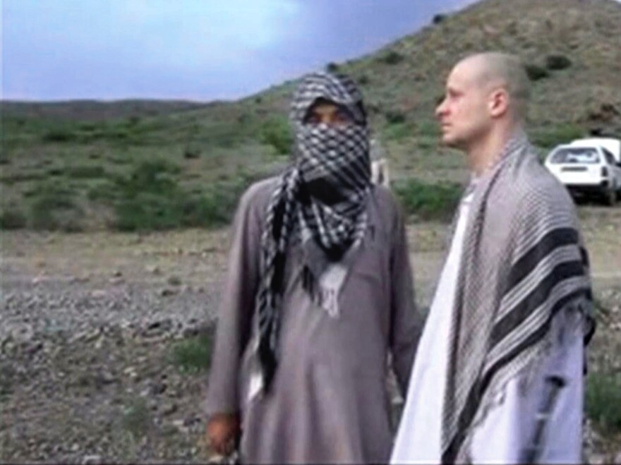 Sgt. Bowe Bergdahl stands with a Taliban fighter in eastern Afghanistan. This image was taken from a video that showed Bergdahl being transferred to the U.S.