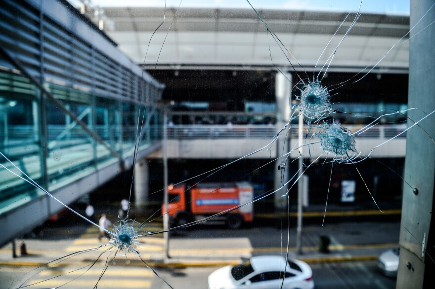 Bullet impacts are pictured at Istanbul's Ataturk airport on Wednesday, a day after a suicide bombing and gun attack killed more than 40 people.