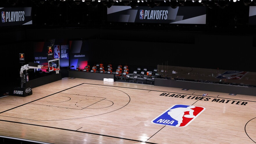A basketball court is empty where the Milwaukee Bucks had been scheduled to play the Orlando Magic on Wednesday in Lake Buena Vista, Fla. The Bucks and other NBA teams boycotted their games following the police shooting of a Black man in Kenosha, Wis.
