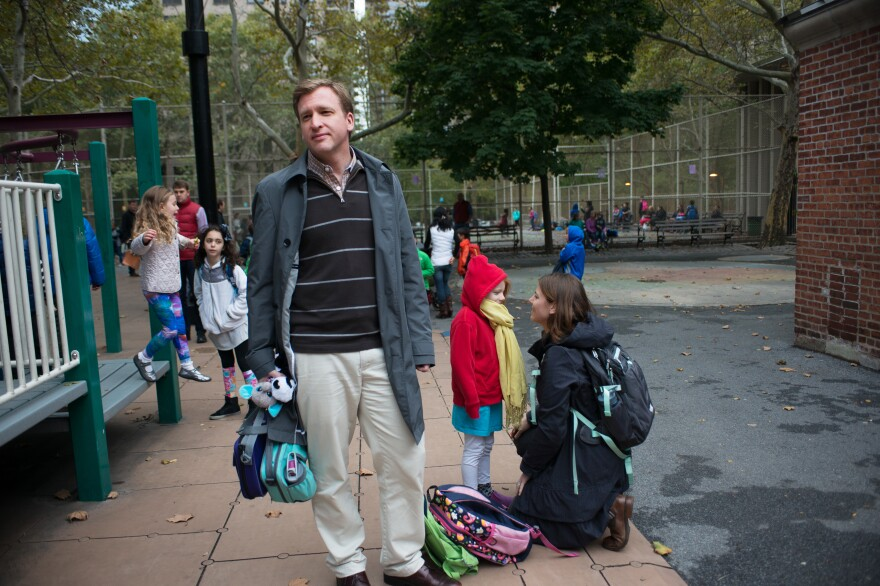 Jason Zimba, one of the writers of the Common Core, waits while his daughters play.
