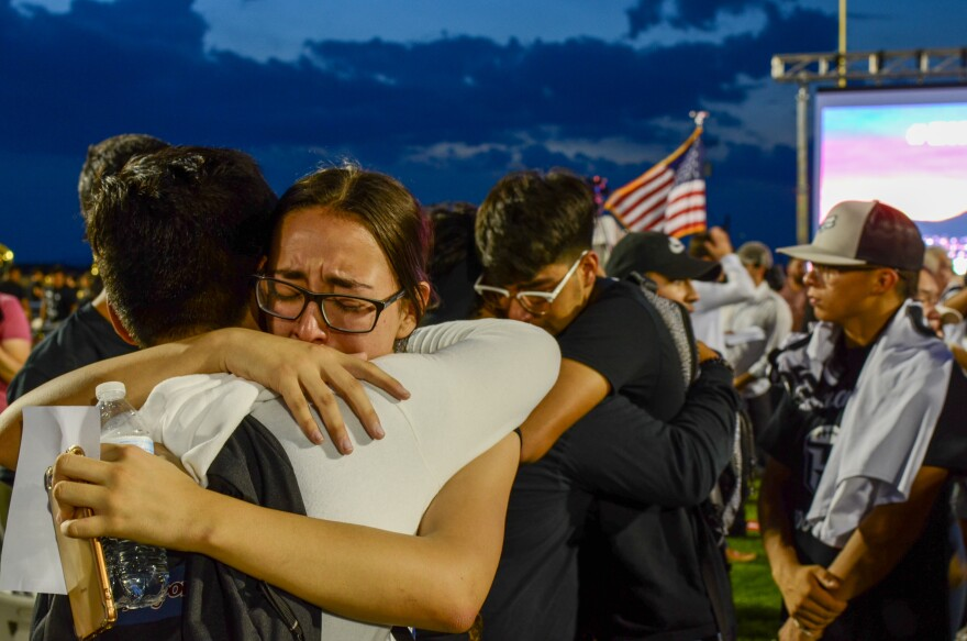 El Paso community members grieve at a memorial for Javier Amir Rodriguez — the youngest of 22 victims who died from a mass shooting at a Walmart on Aug. 3, 2019.