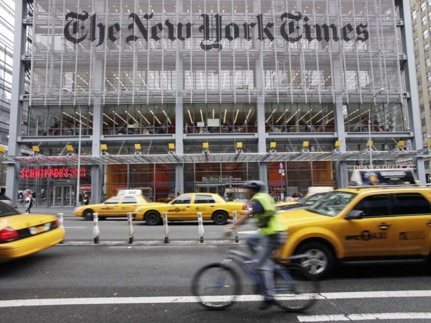<p><em>The New York Times</em>' move to install a pay wall in March was seen as risky, but the paper's profits and its digital subscribers are up, according to third-quarter profit reports.</p>