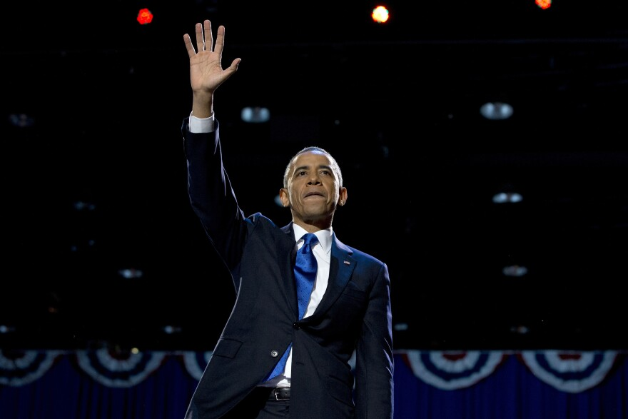 President Obama waves to supporters at an election night party in Chicago to proclaim victory in the 2012 presidential election.