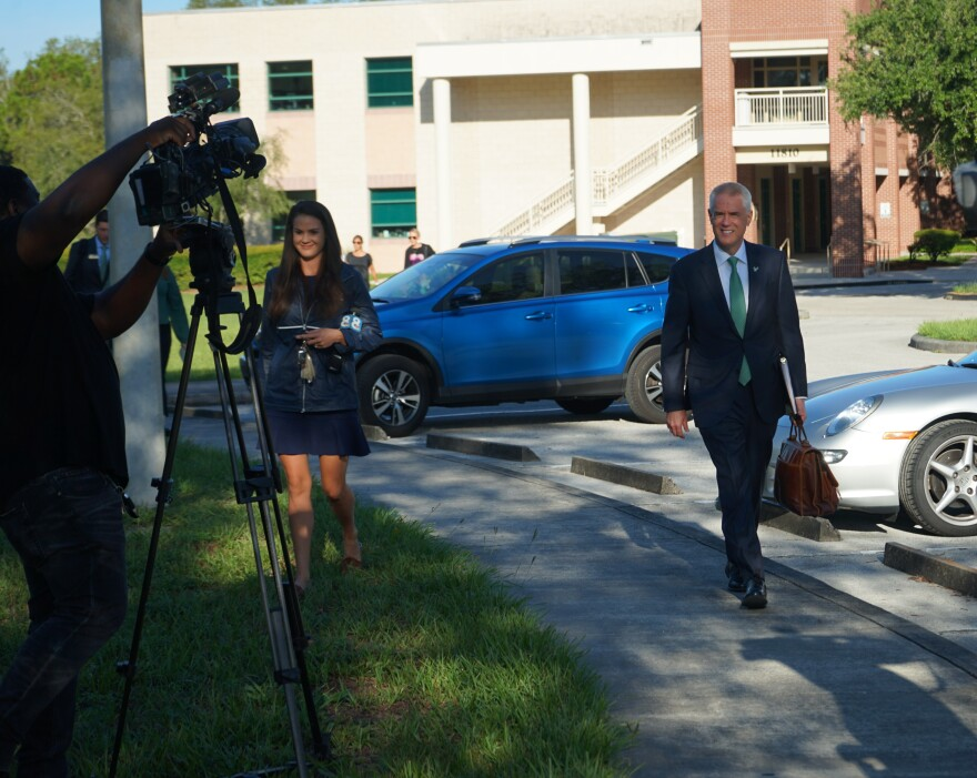 Surrounded by photographers and reporters on his first official day as USF President, Steven Currall walks from the Gibbons Alumni Center to the nearby Patel Center on USF's Tampa campus Monday.