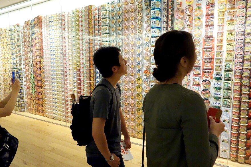 Visitors view a display of Cup Noodles packages from around the world.