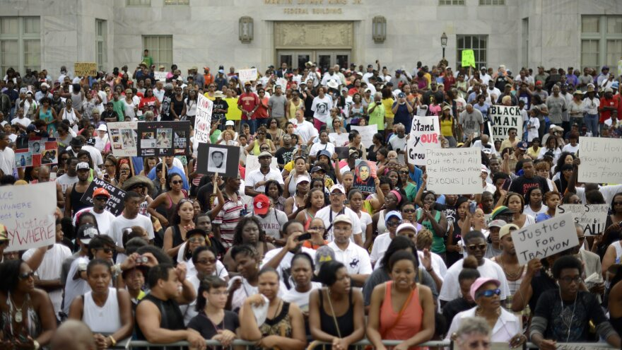 A crowd gathers for a rally in protest of the not-guilty verdict for George Zimmerman in Atlanta on Saturday.