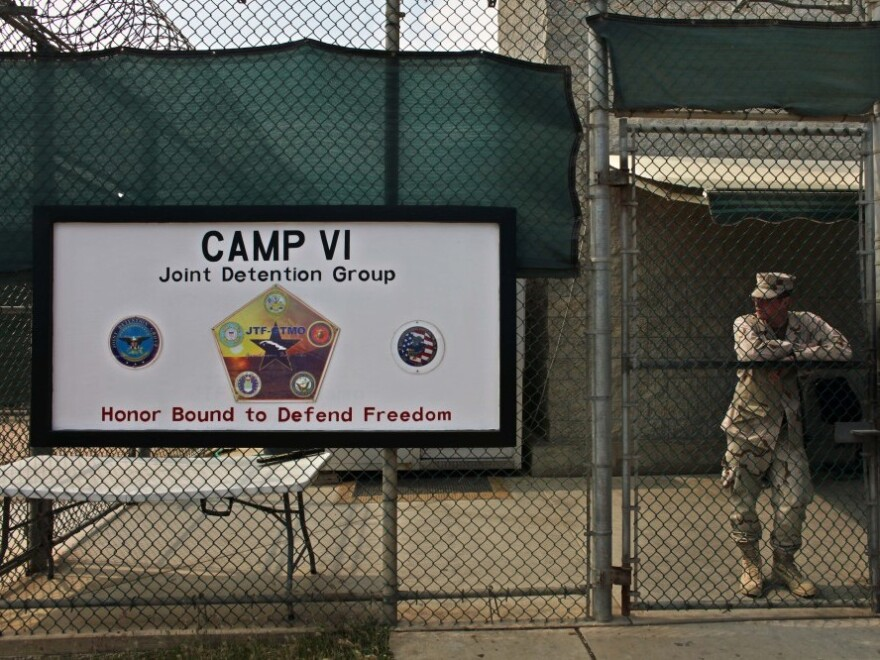 A soldier stands guard at the front gate to Guantanamo's Camp 6 maximum-security detention facility in 2009. Wednesday marks 10 years since detainees first arrived at the detention facility.