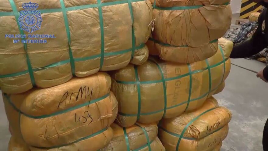 Police found bales of uniforms and accessories in containers that had been labeled as holding secondhand clothes.