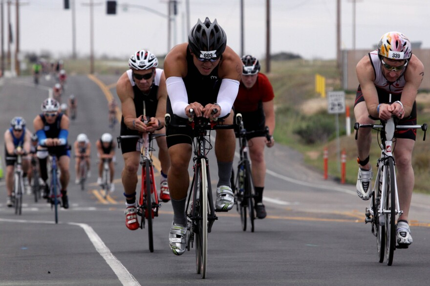 More than 2,400 Marines and civilians biked 56-miles through base during the Ironman 70.3 Triathlon at Oceanside, Calif., March 30, 2013.