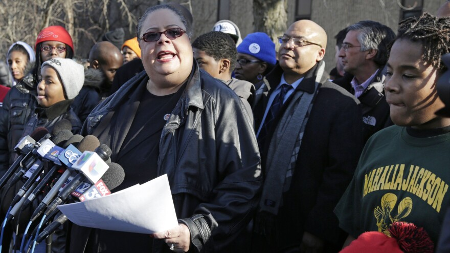 Chicago Teachers Union President Karen Lewis speaks outside Mahalia Jackson Elementary School in Chicago about the planned closing of 54 public schools. Opponents say the plan will disproportionately affect minority students in the nation's third-largest school district.