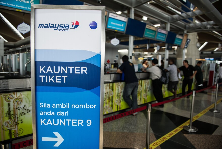 Passengers queue up at Malaysia Airlines ticket counters at Kuala Lumpur International Airport in Sepang on July 21.