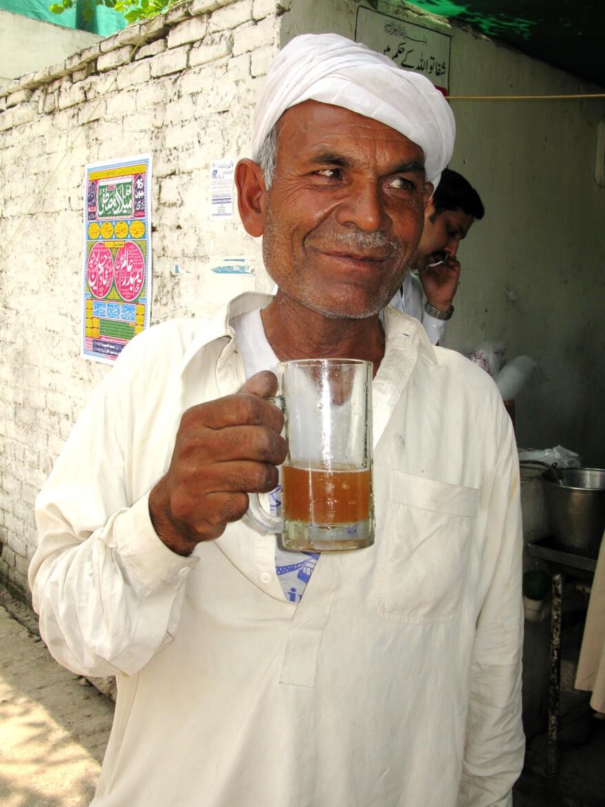 A man drinks aloo pokhara, a heart-comforting prune juice in Islamabad.