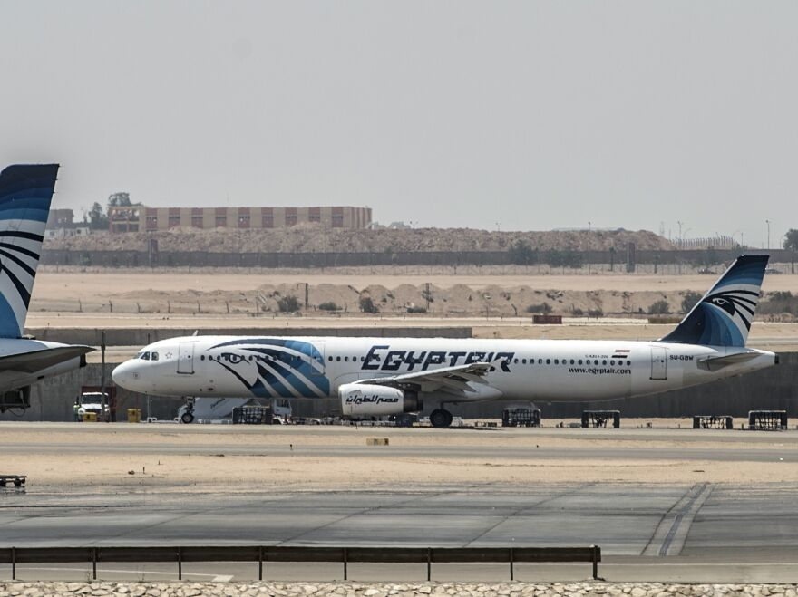 Planes sit on the tarmac at Cairo's airport Thursday after an EgyptAir flight from Paris to Cairo disappeared over the Mediterranean with 66 people onboard.