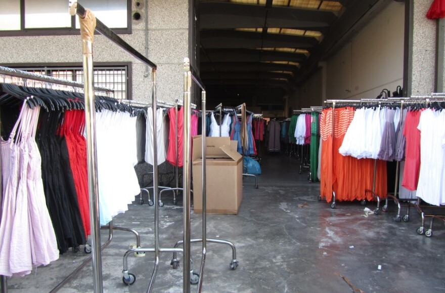 At the Macrolotto industrial park, home of <em>pronto moda</em> — or fast fashion — warehouse after warehouse is filled with racks of low-end, trendy women's garments.