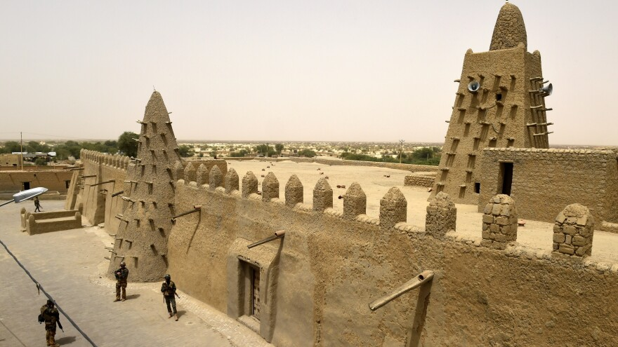 French and Malian soldiers patrol next to the Djingareyber Mosque in Timbuktu in 2015. Several of the city's historic and cultural sites were demolished in 2012, during an occupation by Islamist militants.