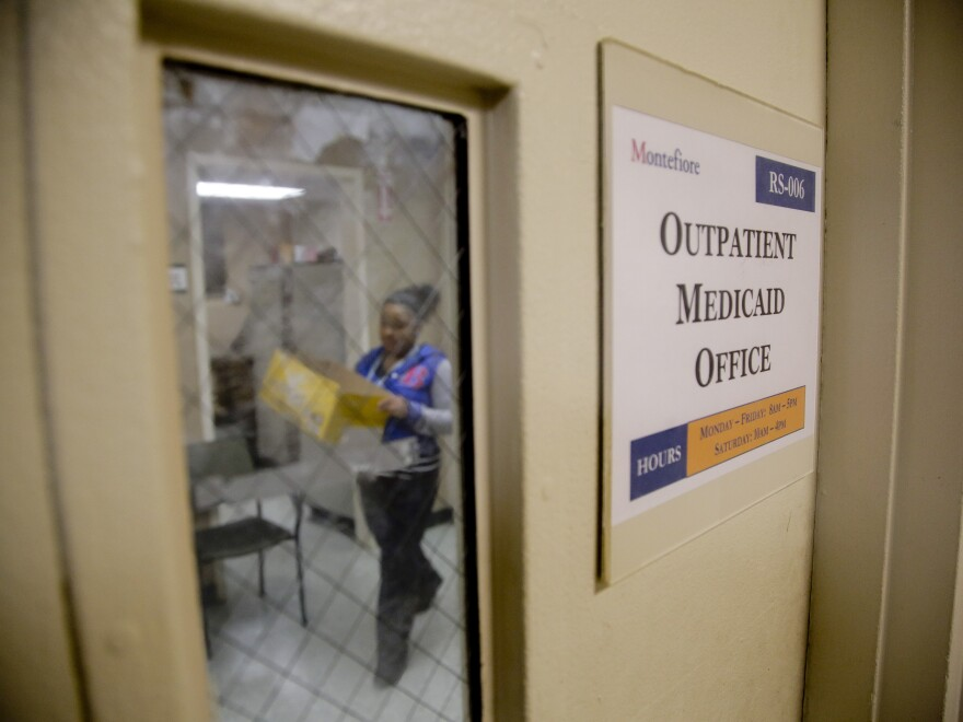 A Medicaid office employee works on reports at Montefiore Medical Center in New York in late 2014. New York expanded Medicaid eligibility under the Affordable Care Act and enrollment surged.