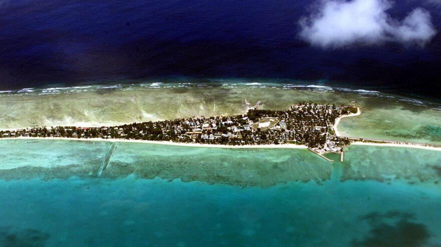 The Gastonguays hoped to reach the vast archipelago nation of Kiribati, part of which is shown in this 2001 photo.