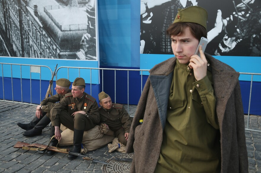 Actors dressed as World War II Soviet Red Army soldiers take a break during rehearsals Thursday at Red Square ahead of Saturday's celebrations.