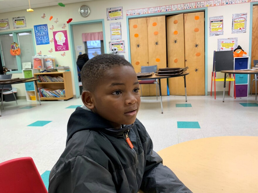 Cameron Tashawn Miller, 6, talks about how he feels about the violence in the Roosevelt Homes where he lives.