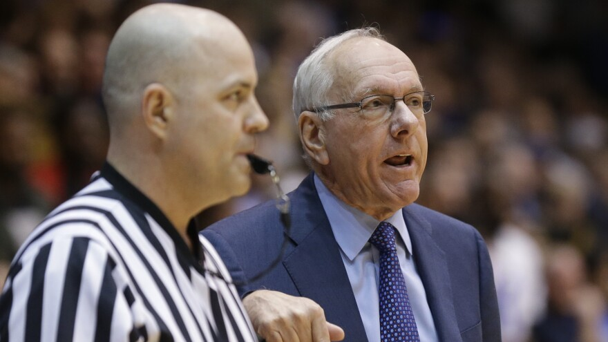 Syracuse coach Jim Boeheim, right, speaks with an official during the first half of an NCAA college basketball game against Duke in Durham, N.C., on Feb. 28