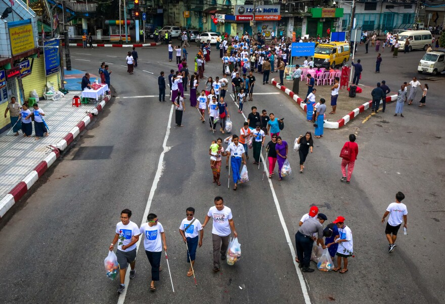 On White Cane Day — October 15 — people with visual impairment in Yangon, Myanmar, took part in an early morning walk down city streets.