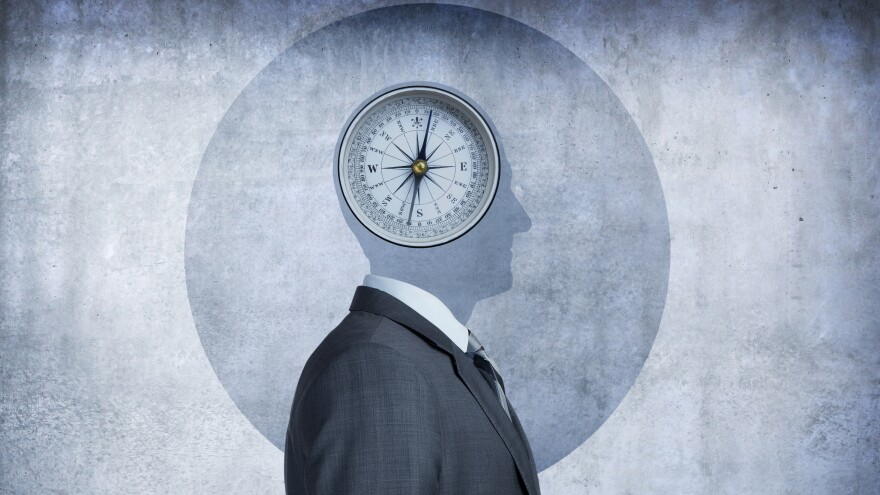 A compass occupies the space over the man's head, conveying the concept of morality and the choices we make.
