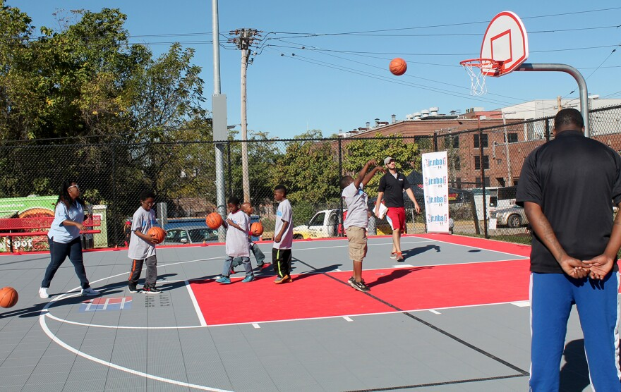 The Jr. NBA, which donated funds for the basketball court at Trojan Park, holds a clinic during the opening ceremonies on Oct. 8, 2016.