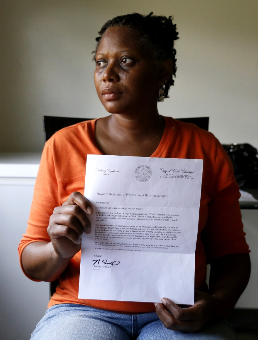 Sherry Jackson shows a letter telling her she must relocate from her West Calumet Housing Complex home in East Chicago, Ind. Jackson has lived at West Calumet Housing Complex for four years but will have to move since the city has decided to demolish complex.