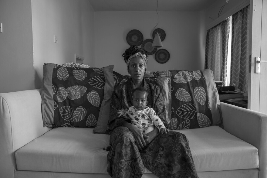 """Sarah Waiswa's self-portrait of herself with Ria at 4 months. """"We went into lockdown a couple of weeks after she was born,"""" she says. """"It's strange not having family around to hold her."""" <em>July 5. Nairobi, Kenya.</em>"""