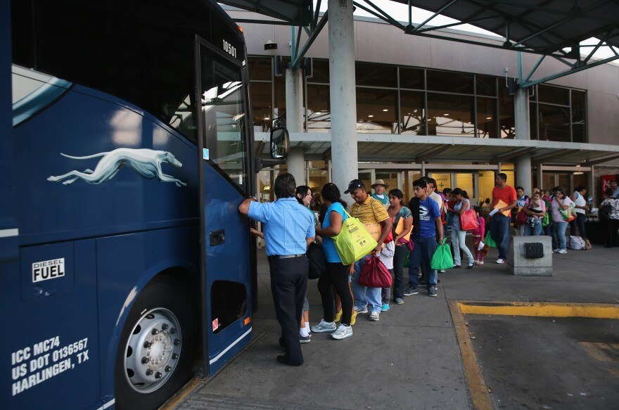 Central American immigrants just released from U.S. Border Patrol detention board a bus for Houston and then other U.S. destinations on July 25, 2014 in McAllen, Texas. Federal agencies have been overwhelmed by tens of thousands of immigrant families and unaccompanied minors from Central America crossing illegally into the United States.