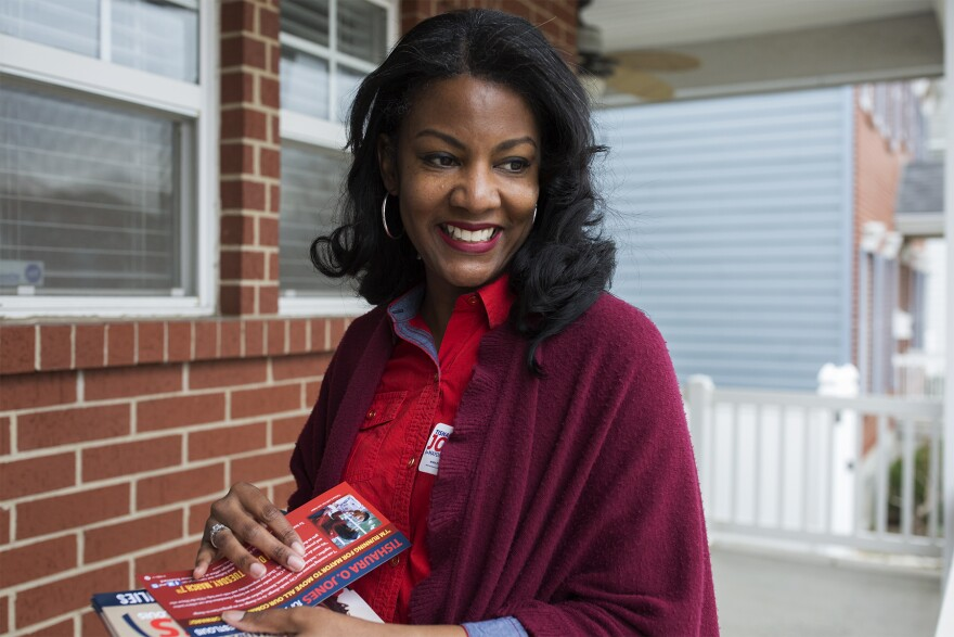 Mayoral candidate Tishaura Jones speaks to passers-by while canvassing the Botanical Heights neighborhood on Feb. 18, 2017.